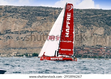 "ALICANTE, SPAIN - OCTOBER 04: The sail boat of the Team Mapfre is sailing in the ""Volvo Ocean Race 2014-2015"" in-port race in Alicante bay, on october 04, 2014 in Alicante. - stock photo"