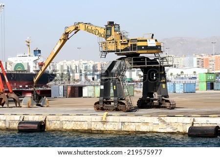 "ALICANTE, SPAIN - SEPTEMBER 05: The caterpillar crane ""Multidock"" is prepared to work in the port of Alicante; on september 05, 2014 in Alicante. - stock photo"