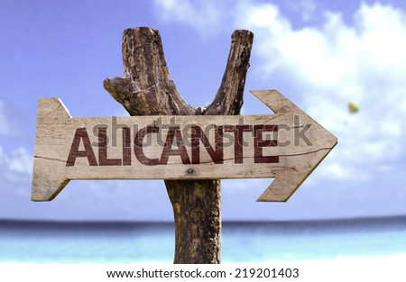 Alicante wooden sign with a beach on background - stock photo