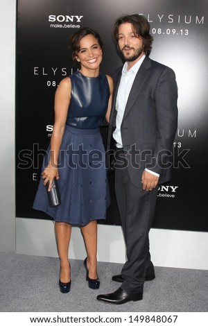 "Alice Braga and Diego Luna at the ""Elysium"" Los Angeles Premiere, Village Theater, Westwood, CA 08-07-13 - stock photo"