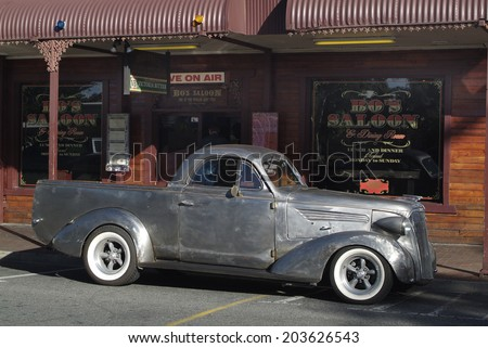 ALICE SPRINGS, AUSTRALIA - APRIL 16: Unidentivied vintage car and bar- restaurant in the city in Australians outback, Northern Territory, on April 16, 2010 in Alice Springs, Australia - stock photo