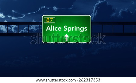 Alice Springs Australia Highway Road Sign at Night - stock photo