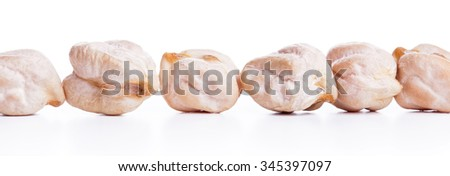 Align raw dry chickpeas on white background, healthy vegan food with a lot of protein