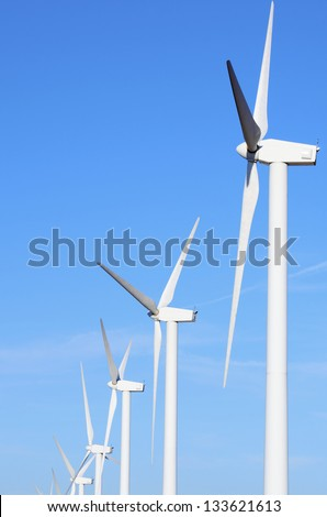 aligned group of windmills for electric power production in Pozuelo de Aragon, Saragossa, Aragon, Spain - stock photo