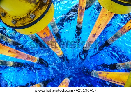 Aligned Oil and Gas Production slots on the sea background in Petroleum Offshore wellhead remote platform, Energy and petroleum industry, Oil and Gas or Petroleum industry is major of the world. - stock photo