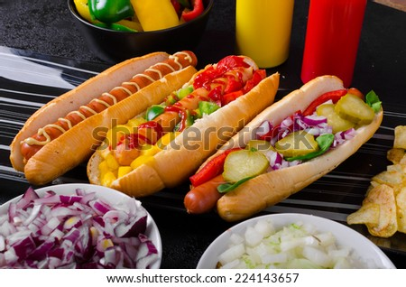 All beef dogs, variantion of hot dogs, onions, beef, garlic, chips, paprika, chilli, mustard, ketchup - stock photo