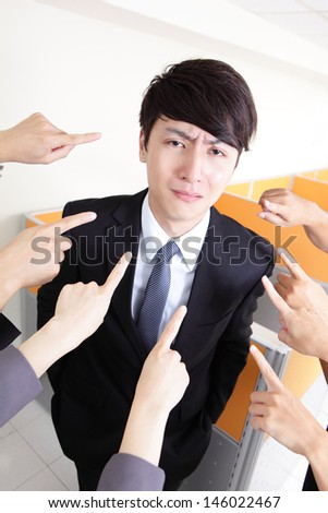 All hands finger pointing at a businessman at office, business concept, asian people - stock photo
