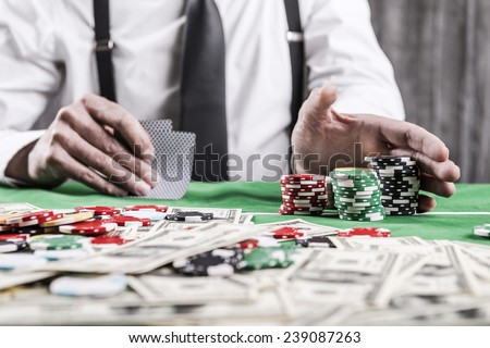 All in. Close-up of man doing all in while sitting at the poker table  - stock photo