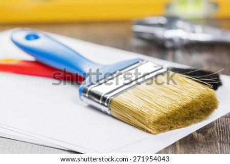 All kinds of plumbing and tools on table - stock photo