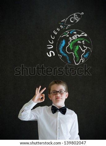 All ok or okay sign boy dressed up as business man with chalk globe and jet world travel on blackboard background - stock photo