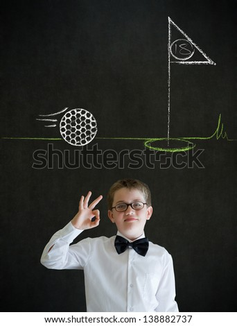 All ok or okay sign boy dressed up as business man with chalk golf ball flag green on blackboard background - stock photo