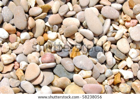 All rounded tiny pebbles from beach, a natural background for especially summer projects - stock photo
