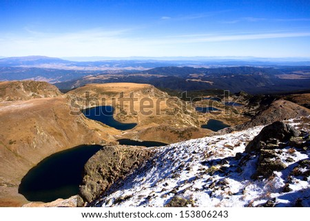 all seven Rila lakes in bulgarian mountain- sunny winter background  - stock photo