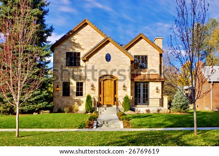 All stone facade two story luxury home in Denver, Colorado, United States. - stock photo