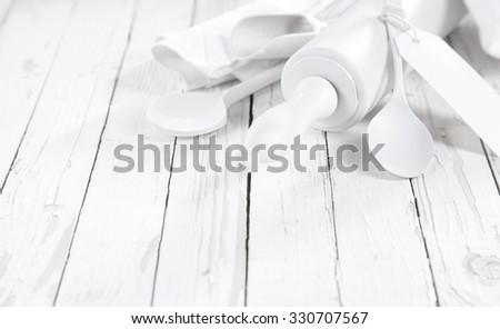 All White baking concept with pure white baking utensils with spoons, rolling pin and scoop on an old rustic white painted wooden table with copyspace - stock photo