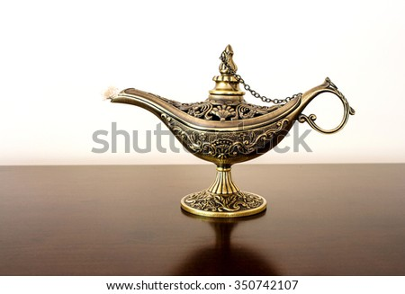 Alladin's Oriental eastern candle lamp with a djinn - stock photo