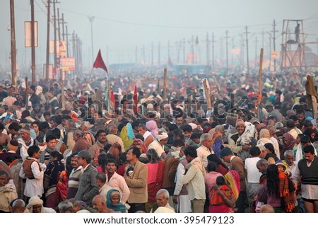 ALLAHABAD, INDIA - FEBRUARY 10, 2013: Hindu devotees come to confluence of the Ganges and Yamuna River for ritual holy bathing during the festival Kumbh Mela. The world's largest religious gathering - stock photo