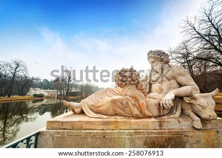 Allegory of the Bug River statue in Lazienki Park (Royal Baths Park), Warsaw, Poland - stock photo