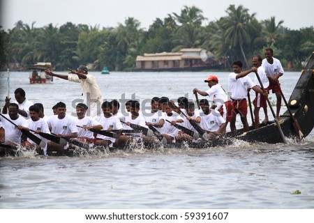 ALLEPPEY, INDIA - AUGUST 14 : A Snake boat team participating in the Nehru Trophy Boat race August 14, 2010 in Alleppey, India. - stock photo