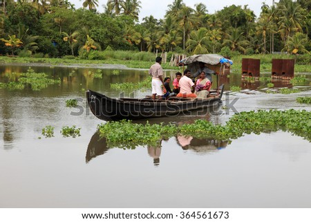ALLEPPEY, INDIA -JUL18 : Unidentified villagers travel by ferry boat in the backwaters on July 18, 2015 in Alleppey, India. People of the region depend on boats for their transporting needs - stock photo
