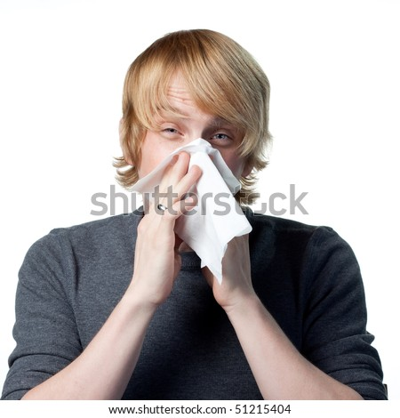 Allergic reactions for this man blowing his nose - stock photo