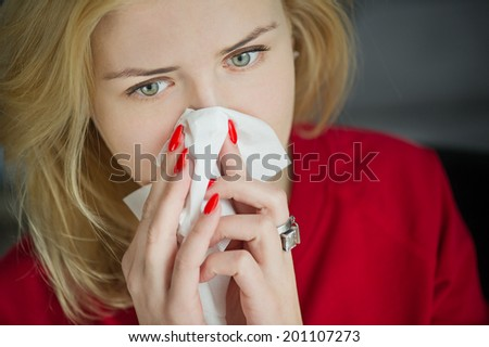 Allergy or cold flu illness tissue blowing runny nose - stock photo