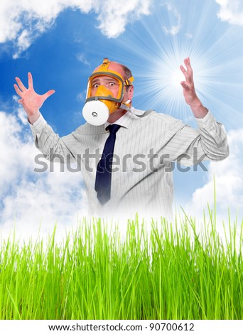Allergy to pollen concept. Young man with protection mask in blooming grass. - stock photo