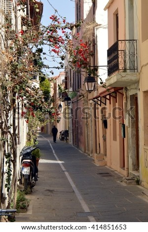 Alley with small house in the city of Rethymnon in Greece. - stock photo