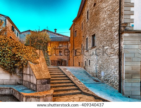 Alleys by night in medieval mountain village in Tuscany characterized by houses with walls of stones derived from the Renaissance - stock photo