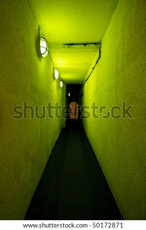 Alleyway bathed in green light, Manchester city centre, UK. - stock photo