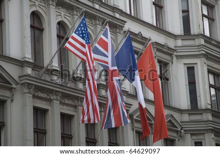 Allied flags in Checkpoint Charlie, Berlin - stock photo