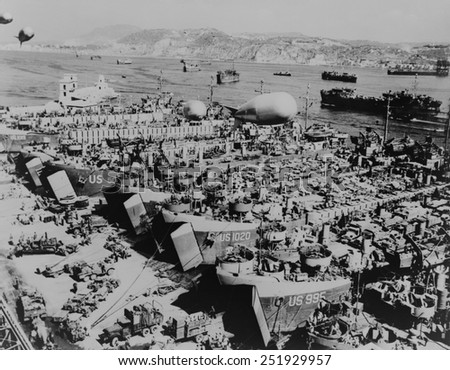 Allied invasion ships in a southern Italian port being loaded with vehicles and supplies. They will assault on the southern coast of France, in Operation Dragoon on August 15, 1944. - stock photo