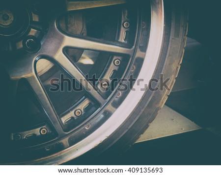 Alloy Car Wheel Closeup. Modern Car Wheel. vintage color - stock photo
