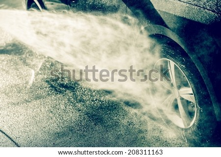 Alloy Wheel Cleaning Using High Pressure Water. Car Wash Cleaning. - stock photo