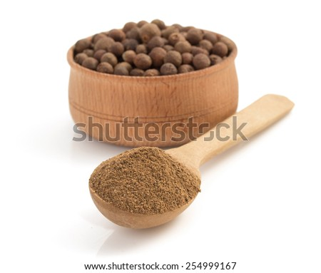 allspice in spoon isolated on white background - stock photo