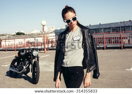 Alluring sexy young girl near old fashioned custom motorcycle. Outdoor lifestyle portrait - stock photo