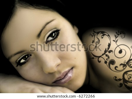 alluring woman with black ornament-tattoo - stock photo