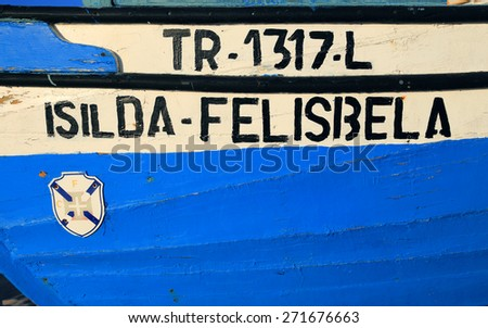 ALMADA, PORTUGAL - FEBRUARY 27: Detail of a typical Portuguese wooden, coastal fishing boat on the Caparica Coast. On February 27, 2015 in Almada, Portugal. - stock photo