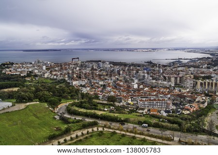 ALMADA, PORTUGAL - NOVEMBER 30: General view on November 30, 2012 in Almada, POrtugal. Neighbour town of Lisbon, at the opposite side of Tagus Estuary. Founded in 1190, has a population of 175,000. - stock photo