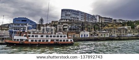 ALMADA - PORTUGAL, NOVEMBER 30: Quay with a ferry of Transtejo Company on November 30, 2012 in Almada, Portugal. Almada is a town in front of Lisbon, founded in 1190, has a population of 100,000. - stock photo