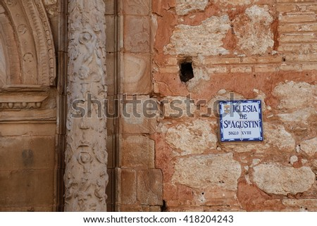 ALMAGRO, SPAIN - APRIL 24, 2016: Facade and door of the church of St. Augustine with the label name in Almagro, Spain, April 24, 2016 in Almagro, Spain - stock photo