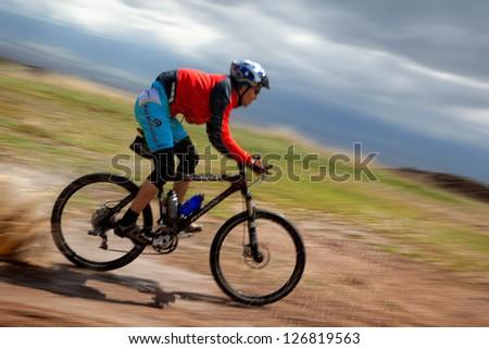 "ALMATY, KAZAKHSTAN - APRIL 30: A.Kaspersky (N6) in action at Adventure mountain bike cross-country marathon in mountains ""Jeyran Trophy 2011"" April 30, 2011 in Almaty, Kazakhstan. - stock photo"