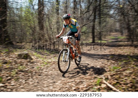 "ALMATY, KAZAKHSTAN - APRIL 19, 2014: A.Nuriev (N29) in action at cross-country competition ""Open season - Bikes relay 2014""  - stock photo"