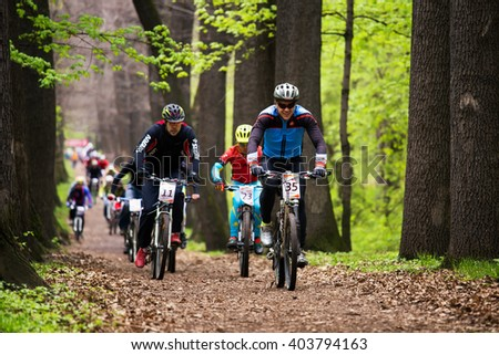 """ALMATY, KAZAKHSTAN - APRIL 10, 2016: D.Vasyliev (35*) in action at cross-country competition """"Open season - Bikes relay 2016""""  - stock photo"""