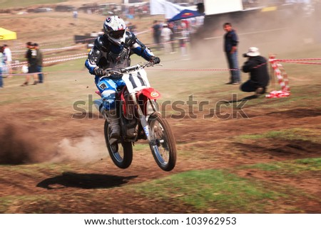 """ALMATY, KAZAKHSTAN - APRIL 22 I.Kostykov (N11) at the Motocross competition """"Fabrichny Cup""""- Open Championship of Kazakhstan on April 22, 2012 in Almaty, Kazakhstan. - stock photo"""