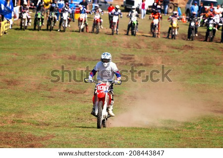 """ALMATY, KAZAKHSTAN - APRIL 22 N.Klimakin (N100) at the Motocross competition """"Fabrichny Cup""""- Open Championship of Kazakhstan on April 22, 2012 in Almaty, Kazakhstan. - stock photo"""