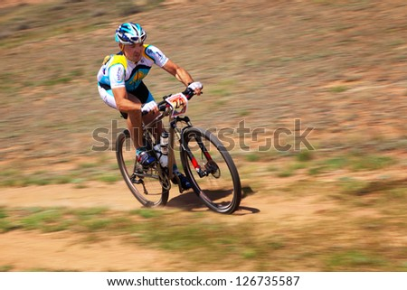 "ALMATY, KAZAKHSTAN - APRIL 30: R.Nurjanov (N24) in action at Adventure mountain bike cross-country marathon in mountains ""Jeyran Trophy 2011"" April 30, 2011 in Almaty, Kazakhstan. - stock photo"