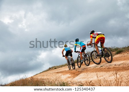 "ALMATY, KAZAKHSTAN - APRIL 30: Unidentified bikers in action at Adventure mountain bike cross-country marathon in mountains ""Jeyran Trophy 2011"" on April 30, 2011 in Almaty, Kazakhstan. - stock photo"