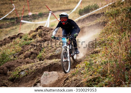 ALMATY, KAZAKHSTAN - AUGUST 22, 2015: L.Gilev (N25) in action at Mountain Bike sports event DOWNHILL EXTREME WEEKEND.  - stock photo