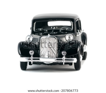ALMATY, KAZAKHSTAN - FEBRUARY 23, 2014: Black Vintage collectible model cars Citroen 15 CV Cyl isolated on white background front view. - stock photo